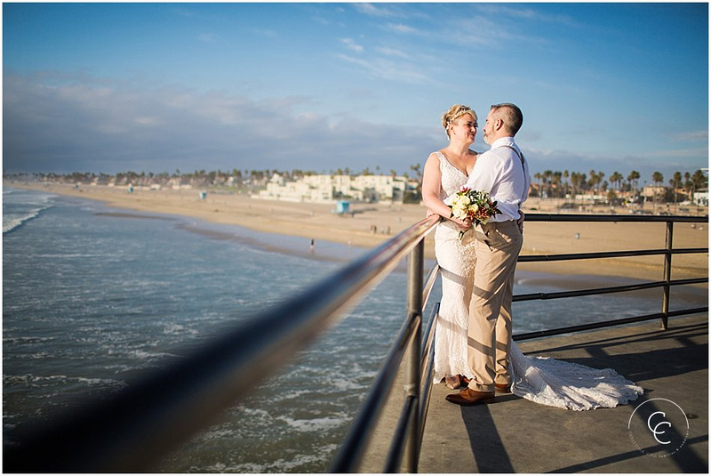 Huntington Beach Elopement Near the Pier wearing Tan and White