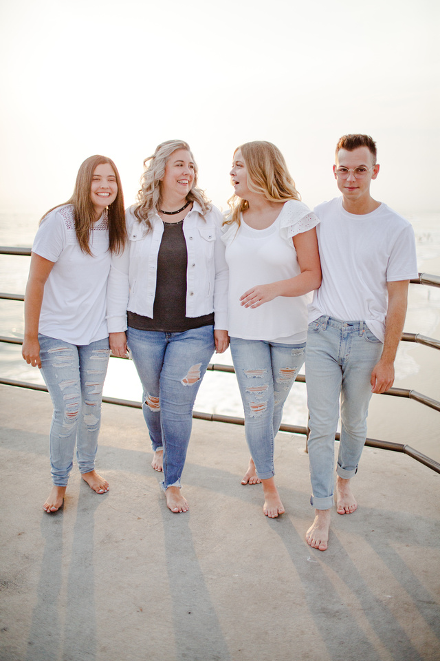 Huntington Beach Pier Family Sunset Session Family Smiling and having fun on vacation in Huntington Beach